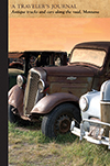Antique trucks and cars along the road, Montana: A Traveler's Journal